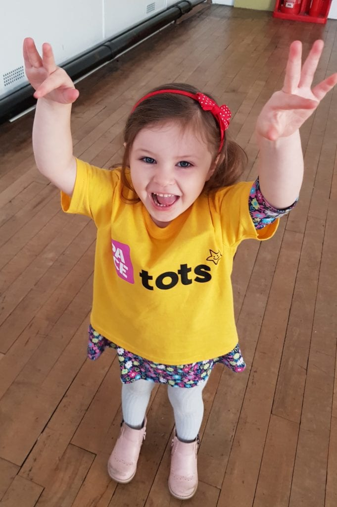 Tot enjoying toddler dance class